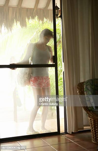 Woman sliding door