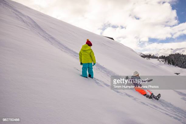 Woman sliding down hill in winter