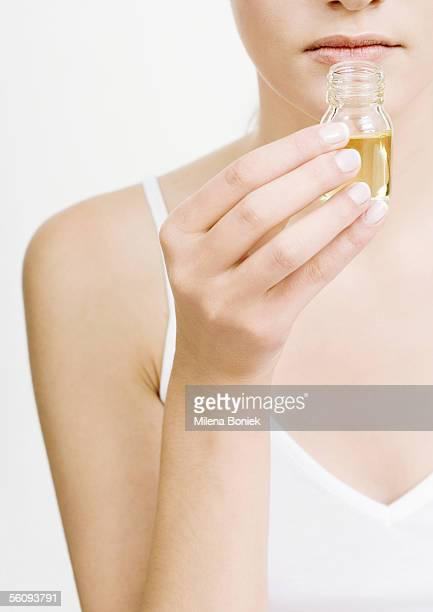 Woman smelling bottle of essential oil