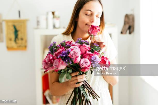 woman smelling bouquet of roses - bunch of flowers stock pictures, royalty-free photos & images