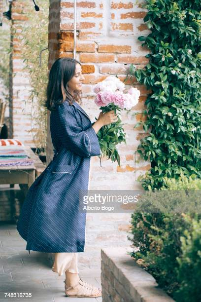 Woman smelling bunch of flowers