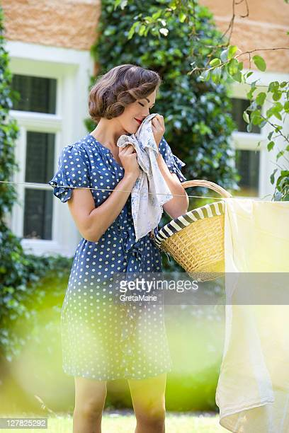 Woman smelling clean clothes