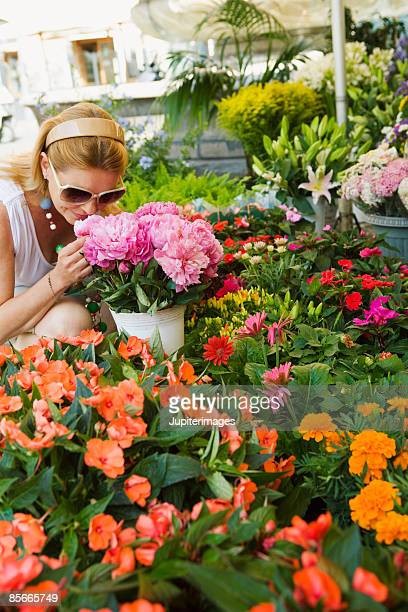 Woman smelling flowers at market
