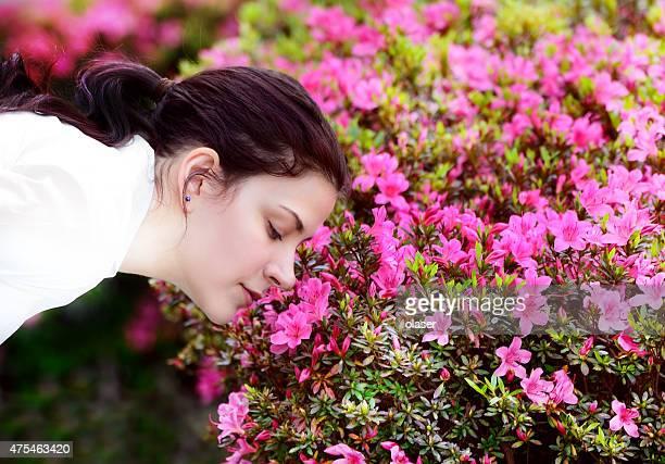 Woman smelling flowers (in Tokyo)