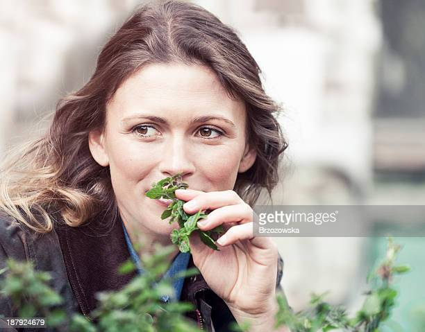 Woman smelling fresh herbs