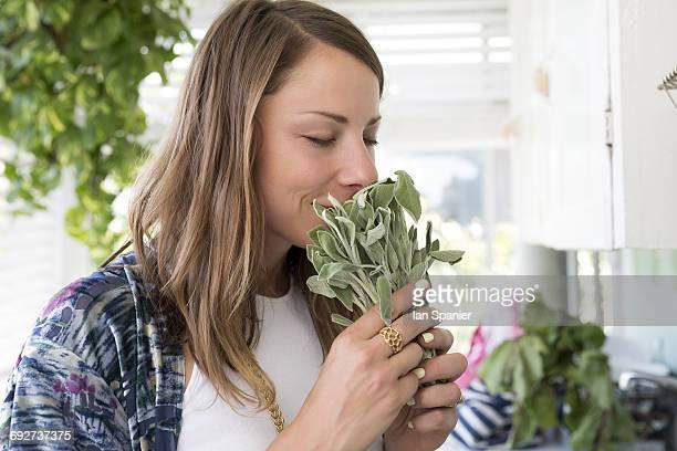Woman smelling fresh herbs