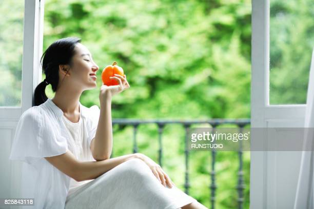 woman smelling fruit