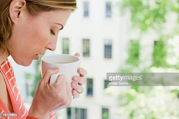 woman smelling herbal tea - herbal tea stock pictures, royalty-free photos & images