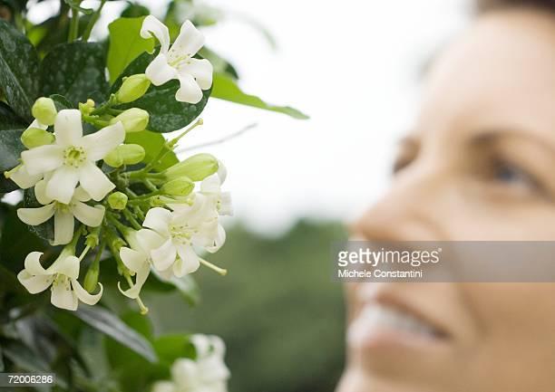 Woman smelling jasmine