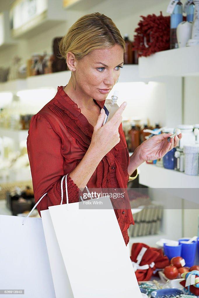 Woman smelling perfume : Stock Photo