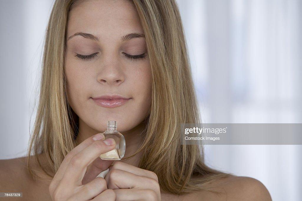Woman smelling perfume. : Stockfoto