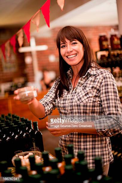Woman smelling preserves in grocery