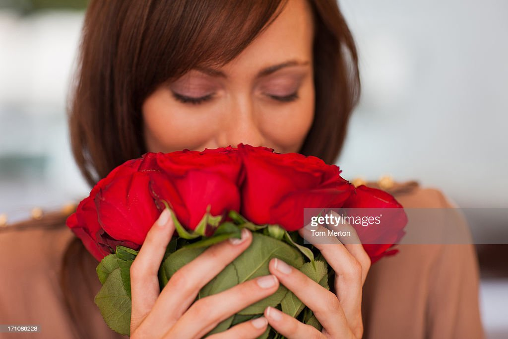 Woman smelling roses : Stock Photo