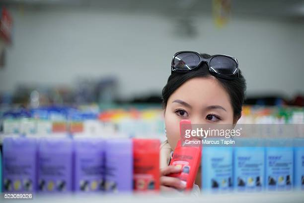 Woman Smelling Shampoo