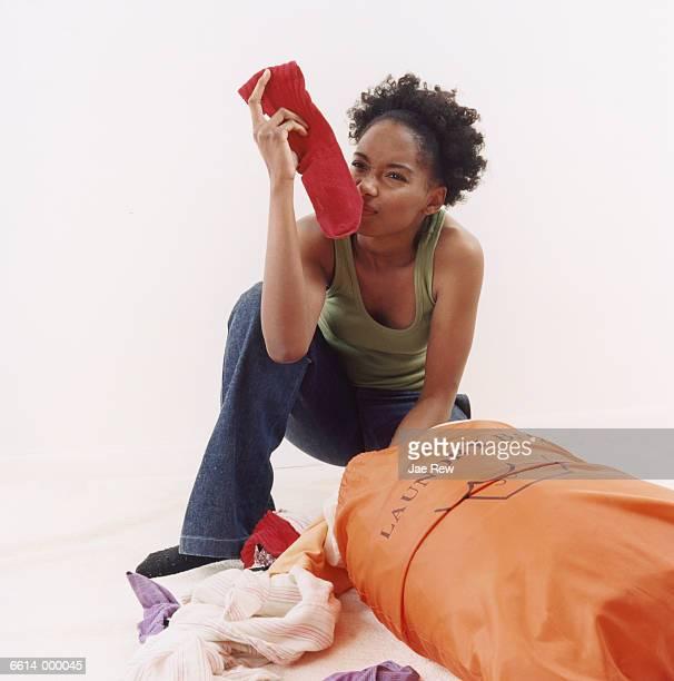 Woman Smelling Sock