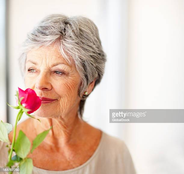 Woman smelling the fragrance of a rose