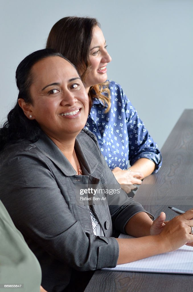 Woman smile during a business meeting : Bildbanksbilder