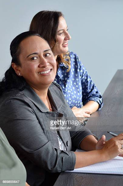 woman smile during a business meeting - rafael ben ari imagens e fotografias de stock