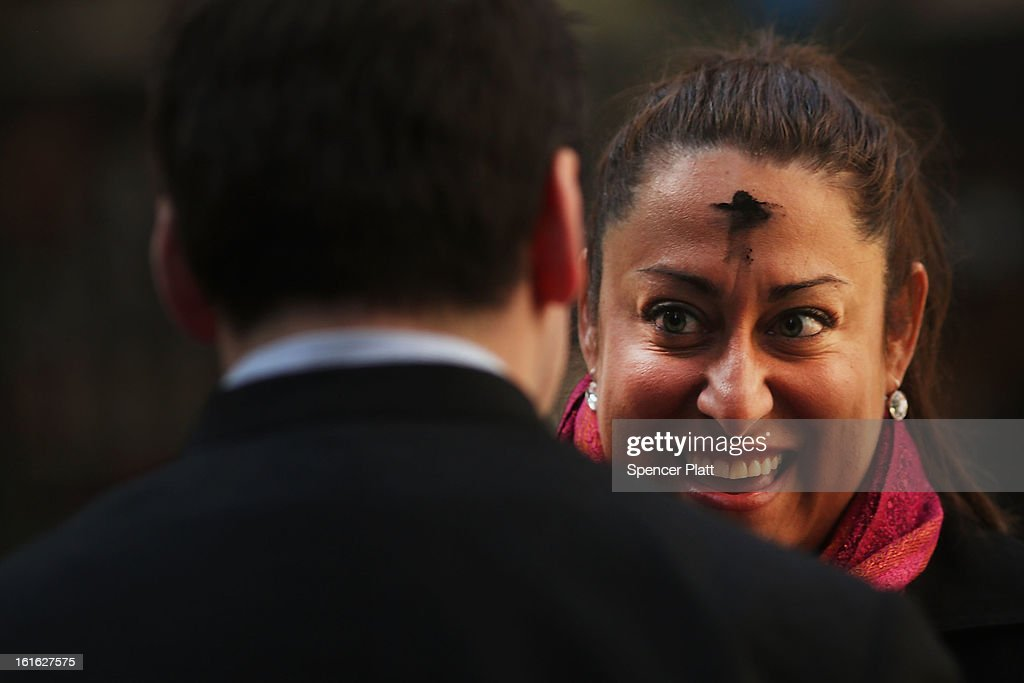 A woman smiles after receiving a cross of black ashes outside of a Catholic church along Broadway on Ash Wednesday on February 13, 2013 in New York City. Ash Wednesday marks the beginning of Lent, a 40-day period of pray and fasting for many Christians.