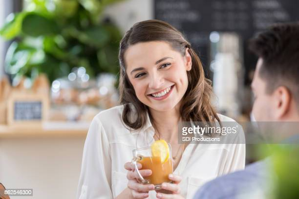 Woman smiles at her date