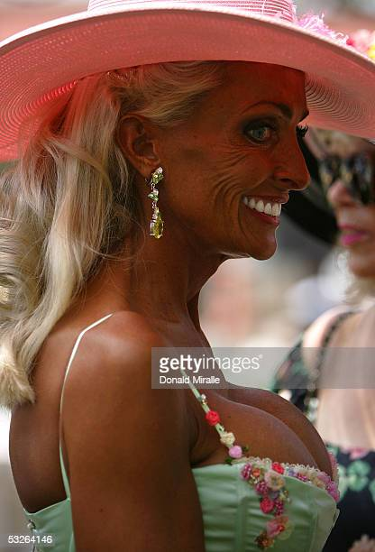 A woman smiles during Opening Day at the Del Mar Thoroughbred Club on July 20 2005 in Del Mar California