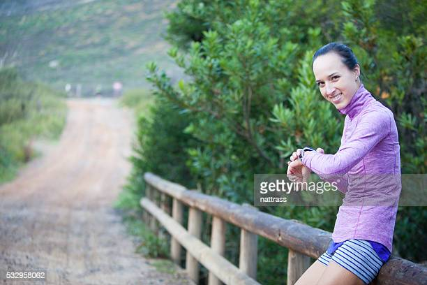 Woman smiles happily after checking her smart running watch