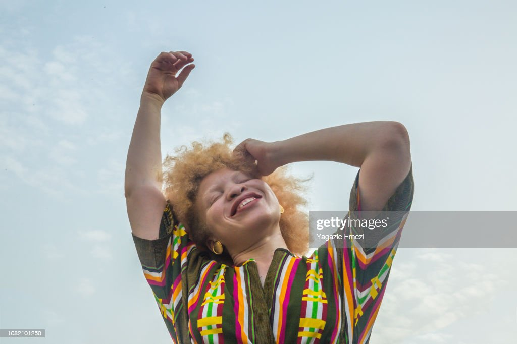 Woman smiling against sky. : Stock-Foto