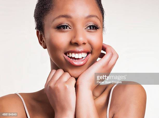 woman smiling and looking to the right - light skin black woman stock photos and pictures