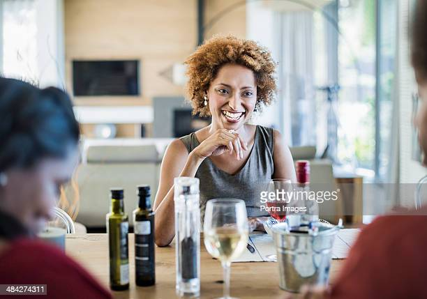 Woman smiling at a dinner table