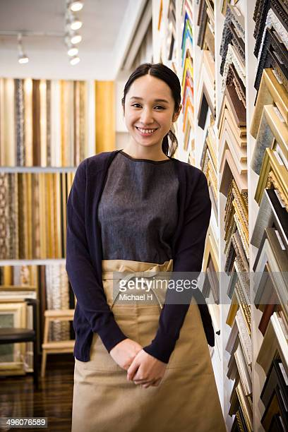 A woman smiling at a frame store