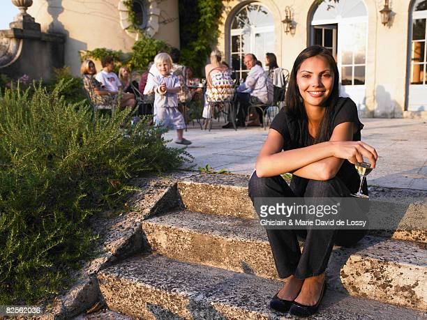 woman smiling at a pre-dinner drink - bordeaux wine stock photos and pictures