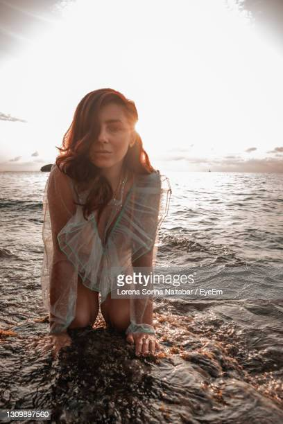 woman smiling at beach against sky - lorena day stock pictures, royalty-free photos & images