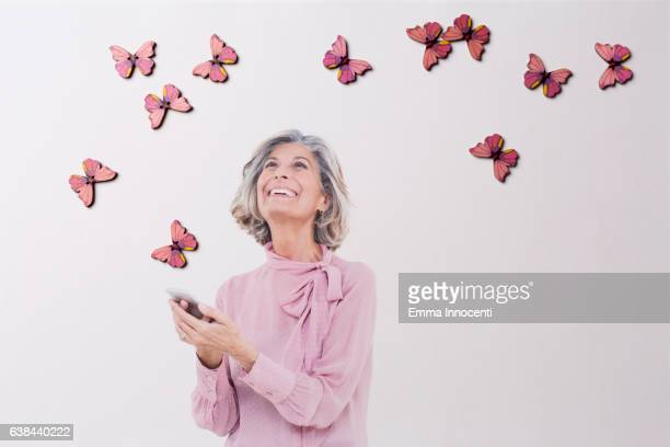 Woman smiling at butterflies