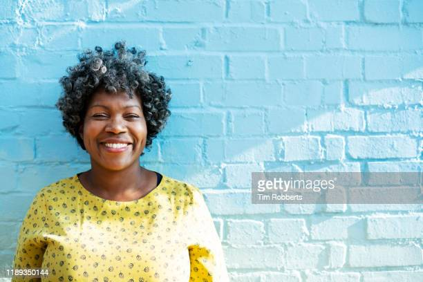 woman smiling at camera - confidence stock pictures, royalty-free photos & images
