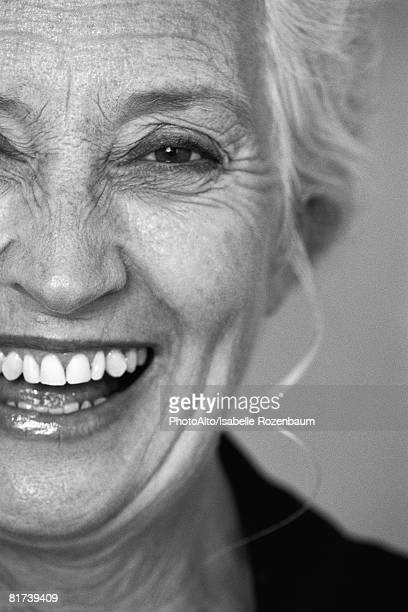 Woman smiling at camera, portrait, cropped