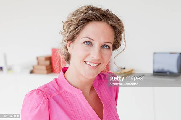 Woman smiling at her office