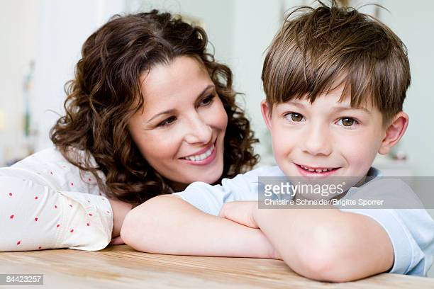 Woman smiling at her young boy