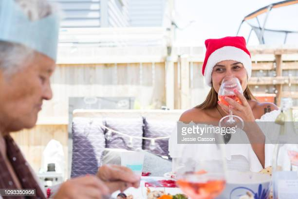 Woman smiling at mother whilst drinking wine