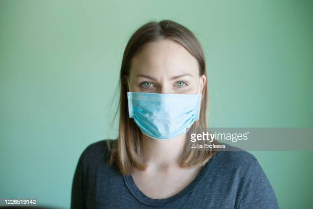 woman smiling behind the mask - russia stock pictures, royalty-free photos & images