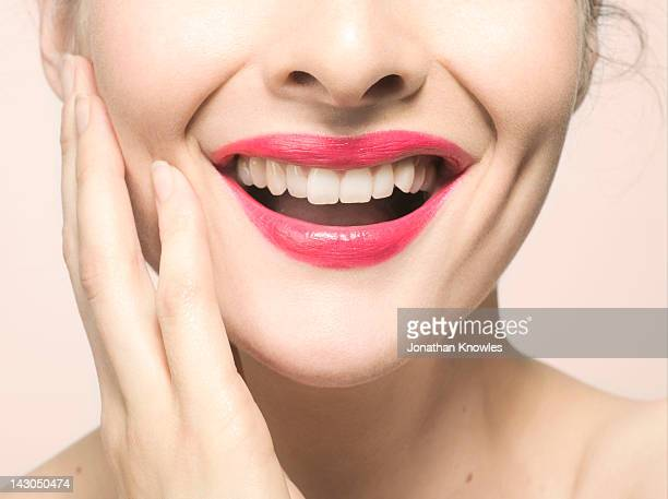 Woman smiling, close up on lips