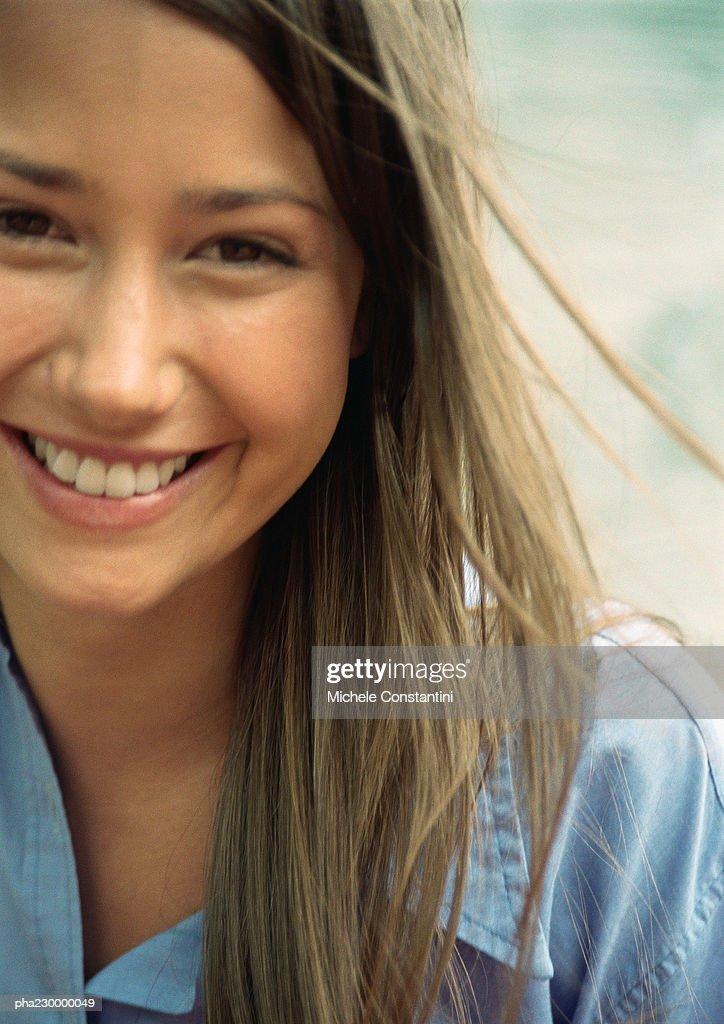 Woman smiling, close up portrait. : Stockfoto
