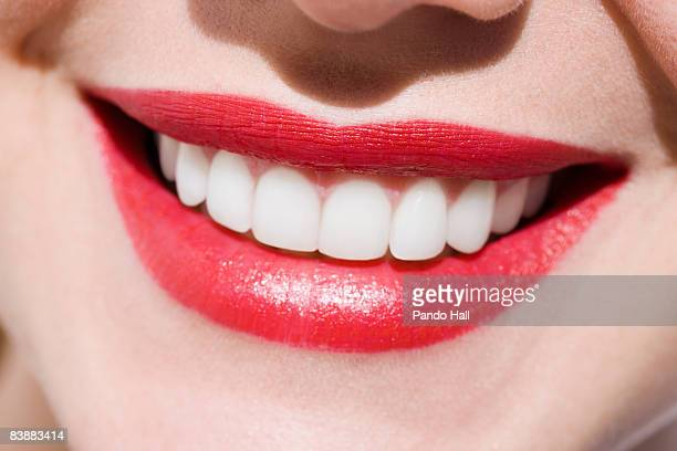 Woman smiling, close-up of mouth, red lips