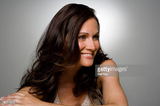 woman smiling, close-up - one mature woman only stock pictures, royalty-free photos & images