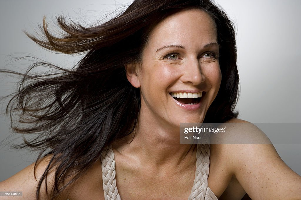 Woman smiling, close-up : Stock Photo