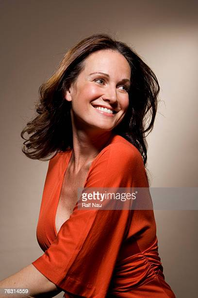 woman smiling, close-up - red dress stock photos and pictures