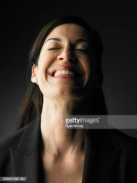 Woman smiling, head back, eyes closed