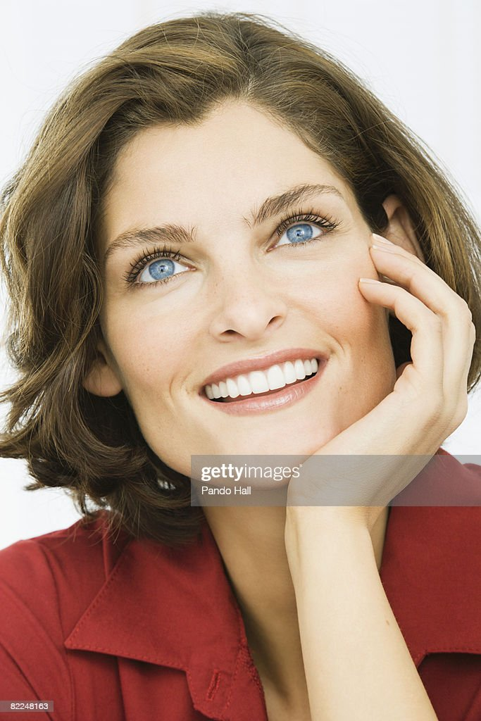 Woman smiling, head on hand, portrait : Stock Photo