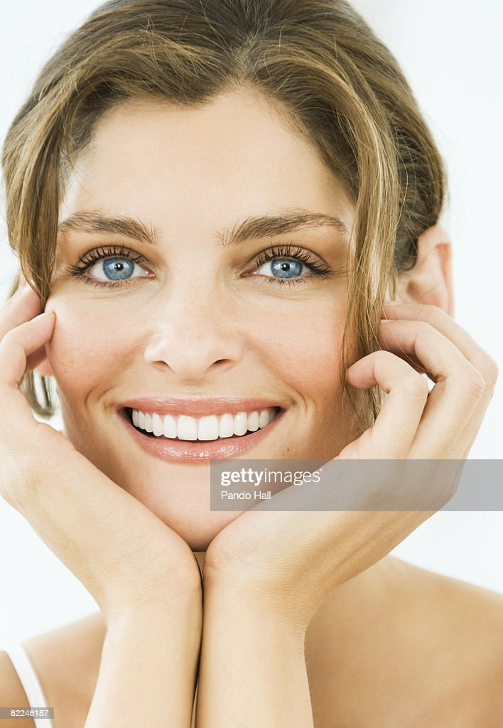 Woman smiling, head on hands, portrait : Stock Photo
