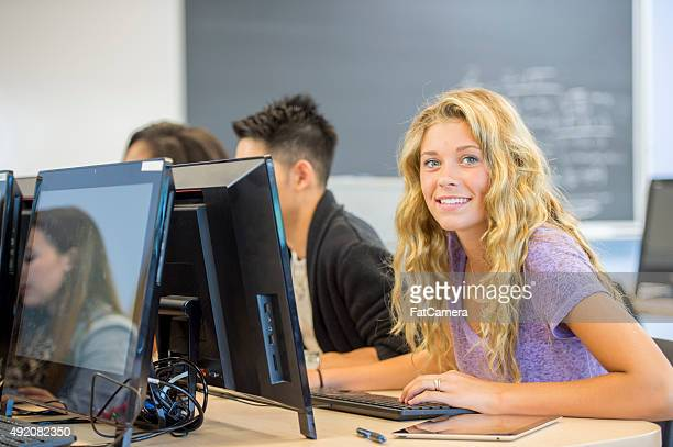 Woman Smiling in a Classroom