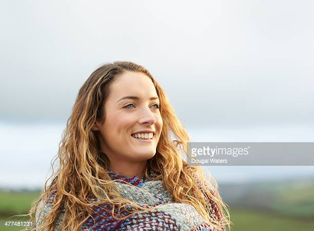 Woman smiling in countryside.